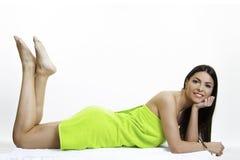 Beautiful girl in green towel beauty body care concept. Beautiful girl in towel enjoying royalty free stock image