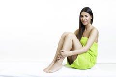 Beautiful girl in green towel beauty body care concept. Beautiful girl in towel enjoying stock image