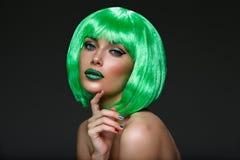 Beautiful girl in green wig Stock Photography