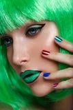 Beautiful girl in green wig Stock Image