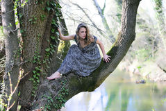 Beautiful girl in green wood by summer Royalty Free Stock Photography