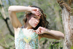 Beautiful girl in green wood by summer Stock Photos