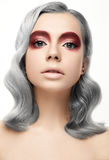 Beautiful girl with a grey curl hair and creative makeup. Beauty face Royalty Free Stock Photography