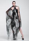 Beautiful girl with grey fashion scarf on grey Stock Photos
