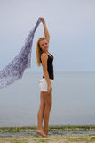 Beautiful Girl With Grey Scarf on The Beach. Travel and Vacation. Freedom Concept stock photos