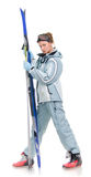 Beautiful girl with grey sports suit and skis Royalty Free Stock Photography