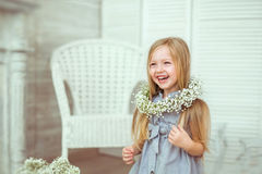 A beautiful girl is grinning all over her face stock photo