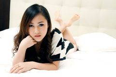 Beautiful girl groveling in bed Royalty Free Stock Image