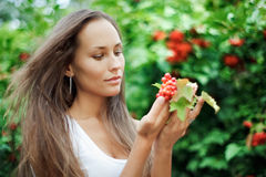 Beautiful girl with guelder rose. In hands Royalty Free Stock Image