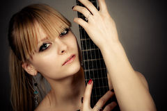Girl with a guitar fretboard Royalty Free Stock Photography