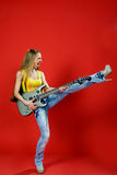 Beautiful girl with a guitar screaming Royalty Free Stock Image