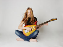 Beautiful girl with guitar royalty free stock image