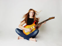 Beautiful girl with guitar Stock Photography