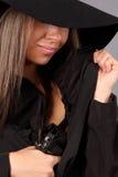 Beautiful girl with gun. Beautiful girl hiding a pistol Royalty Free Stock Photos