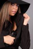 Beautiful girl with gun. Beautiful girl hiding a pistol Royalty Free Stock Images
