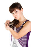 Beautiful girl with a gun shooting straight Stock Image