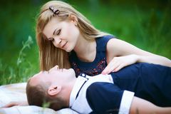 Beautiful girl and guy in forest royalty free stock photo