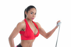 Beautiful girl and  gym equipment Royalty Free Stock Photos