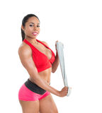 Beautiful girl and  gym equipment Stock Image
