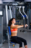 Beautiful girl at the gym exercising on trainers Royalty Free Stock Photo