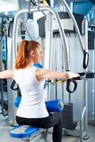 Beautiful girl at the gym exercising on trainers. Beautiful girl.  Royalty Free Stock Photography