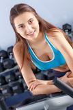 Beautiful girl at the gym exercising on trainers. Beautiful girl.  Stock Photos