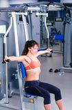 Beautiful girl at the gym exercising on trainers. Beautiful girl.  Royalty Free Stock Image