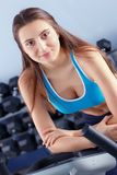 Beautiful girl at the gym exercising on trainers. Beautiful girl.  royalty free stock images