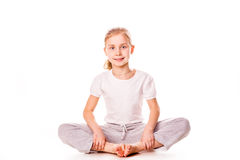 Beautiful girl gymnast  exercising, stretching Royalty Free Stock Images