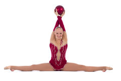 Beautiful girl gymnast with a red ball. Beautiful girl gymnast with a ball over white background stock photography