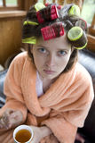 Beautiful girl in hair curlers. Stock Photos