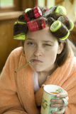 Beautiful girl in hair curlers. Stock Image