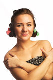 Beautiful girl with hair curlers Royalty Free Stock Photos