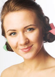 Beautiful girl with hair curlers Stock Image