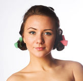 Beautiful girl with hair curlers Stock Photos