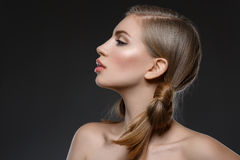 Beautiful girl with hair nods Stock Photography