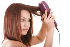 Beautiful girl with hair straightener. Royalty Free Stock Images