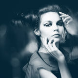 Beautiful girl with a hairdress Stock Photography