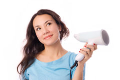 Beautiful girl with a hairdryer Stock Image
