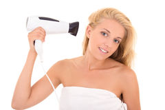 Beautiful girl with hairdryer isolated on white Royalty Free Stock Photo