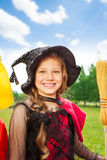 Beautiful girl in Halloween costume of witch Stock Photo