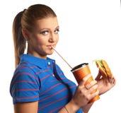 Beautiful girl with hamburger and soda Stock Image