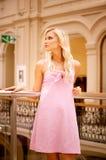 Beautiful girl at handrail Stock Photos