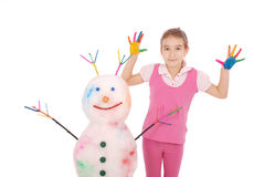 Beautiful girl with hands in paint near color snowman with colored horns and hands Stock Images