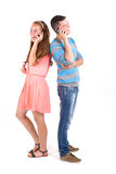 Beautiful girl and handsome boy calling Stock Image