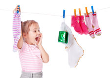 Beautiful girl hangs socks Stock Photo