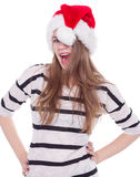 Beautiful girl Happy Christmas and New Year holidays full of fun. Portrait of joyful pretty woman in red santa claus hat laughing isolated on white background Royalty Free Stock Photos