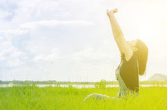 Beautiful girl happy in grass field Royalty Free Stock Photos