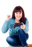 Beautiful girl happy, playing video games Royalty Free Stock Photos