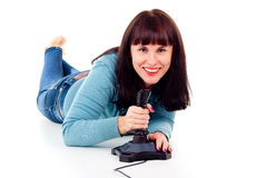 Beautiful girl happy, playing video games Royalty Free Stock Images